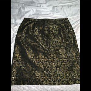 Black Elegant skirt with gold detail.